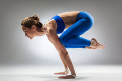 The yoga woman. Young beautiful yoga posing on a studio background Stock Photos
