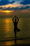 Yoga women silhouette. Working on poses at sunset Stock Photo