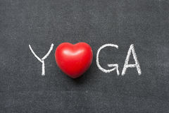 Yoga word. Handwritten on chalkboard with heart symbol instead of O Royalty Free Stock Photos