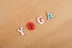 Yoga. word on wooden background composed from colorful abc alphabet block wooden letters, copy space for ad text Stock Photography