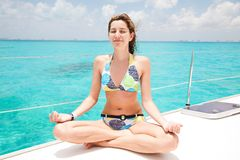 Yoga on the yacht Royalty Free Stock Photo
