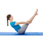 Yoga - young beautiful woman doing yoga asana excerise isolated Royalty Free Stock Image