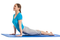 Yoga - young beautiful woman doing yoga asana excerise isolated Royalty Free Stock Images