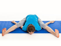 Yoga - young beautiful woman doing yoga asana excerise isolated Royalty Free Stock Images