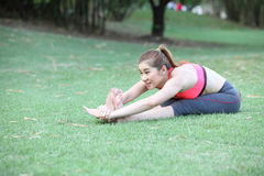 Yoga - young beautiful woman yoga instructor doing Seated Forwar Royalty Free Stock Images