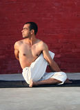 Yoga. Young boy performing different postures of yoga Royalty Free Stock Image