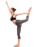 Yoga. Young fit woman doing yoga exercise on white background. Side view Stock Photos