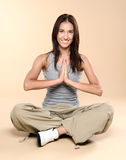 Yoga. Young girl goes in for sports. Royalty Free Stock Photography