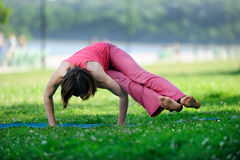 Yoga. Young girl goes in for sports. Royalty Free Stock Images
