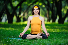 Yoga. Young girl goes in for sports. Royalty Free Stock Photo