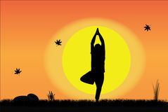 Yoga by Young Man at sunrise or sunset Royalty Free Stock Photo