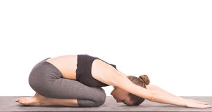 Yoga. Young slim woman in studio practicing yoga and relaxing Royalty Free Stock Photos