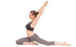 Yoga. Young woman doing yoga asana in pigeon pose Stock Photos
