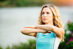 Yoga. Young woman doing yoga exercise Stock Photo