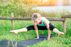 Yoga. Young woman doing yoga exercise Royalty Free Stock Images