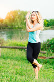 Yoga. Young woman doing yoga exercise Stock Image