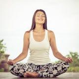 Yoga. Young woman doing yoga exercise outdoor Stock Photo