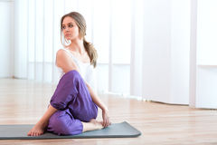 Yoga. Young woman practicing a yoga Royalty Free Stock Images