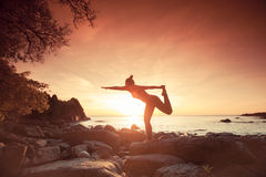 Yoga. With young woman on sunset sky royalty free stock photos