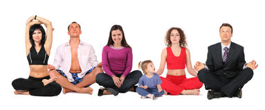 Yogaleutegruppe mit Kind Stockfoto