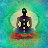 Yogalotoshaltung. Padmasana mit farbigen chakra Punkten. Stockfoto
