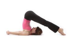 Yogatrainieren der jungen Frau Stockfotos