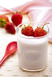 Yoghurt. A glass of yoghurt with fresh strawberry Royalty Free Stock Photos