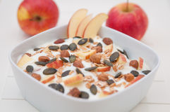 Yoghurt with apple and pumpkin seeds Royalty Free Stock Images