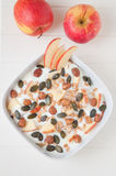 Yoghurt with apple and pumpkin seeds Stock Image
