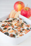 Yoghurt with apple and pumpkin seeds Stock Photography
