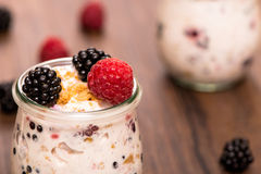 Yoghurt with blackberries and raspberries Royalty Free Stock Photos