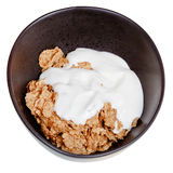 Yoghurt into bowl of cereal Stock Photo