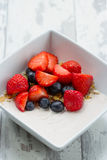 Yoghurt with cereals and fresh fruits Royalty Free Stock Photography