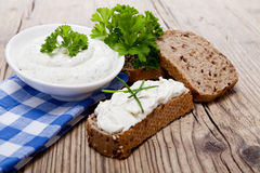 Yoghurt creamy cheese with herbs and bread Royalty Free Stock Images