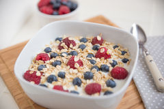 Yoghurt with fresh fruits. And oatmeal stock photos