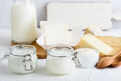 Yoghurt. Fresh organic dairy products. On white table, , selective focus stock photo