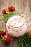 Yoghurt with Fresh Strawberries Stock Images