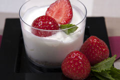 Yoghurt and fruit dessert. An individual yoghurt and fruit dessert Royalty Free Stock Photo