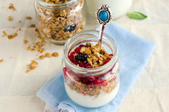 Yoghurt in a glass jar with muesli Royalty Free Stock Images