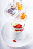 Yoghurt with goji berries, chia seeds and honey stock image