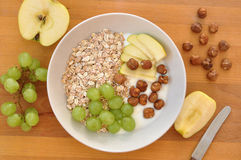 Yoghurt with granola. Hazelnuts, grapes and apples stock photos