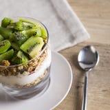 Yoghurt, granola and kiwi Royalty Free Stock Image