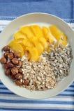 Yoghurt with granola and peach Stock Photos