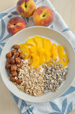 Yoghurt with granola and peach Royalty Free Stock Photos