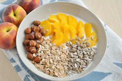 Yoghurt with granola and peach Royalty Free Stock Images
