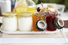 Yoghurt and jams. For breakfast stock images
