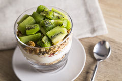 Yoghurt, kiwi and granola Stock Photo
