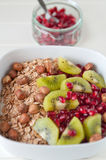 Yoghurt with kiwi and pomegrante seeds Royalty Free Stock Photos