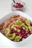 Yoghurt with kiwi and pomegrante seeds Royalty Free Stock Images