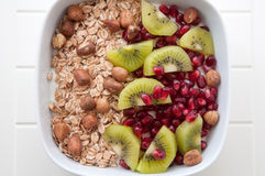 Yoghurt with kiwi and pomegrante seeds Stock Photo
